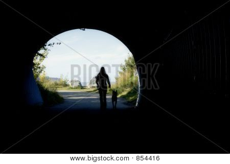 girl with dog in tunnel