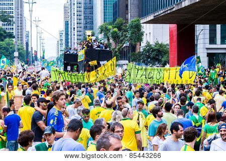 SAO PAULO, BRAZIL - CIRCA MARCH 2015: Protesters marching on Paulista Avenue holding signs with messages against the corruption of Brazilian government in Sao Paulo, Brazil.