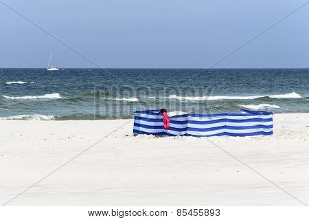 Windbreak On A Wide Golden Beach At The Polish Seaside