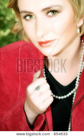Young Blond Woman In Red Jacket