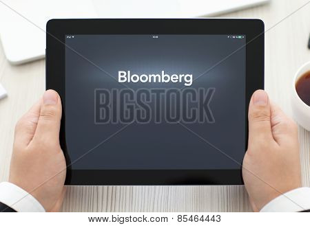 Ipad With App Bloomberg In The Hands Of A Businessman