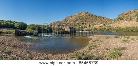 Portugal; Alentejo; Europe - Old traditional water mill in Guadiana River - city of Mertola