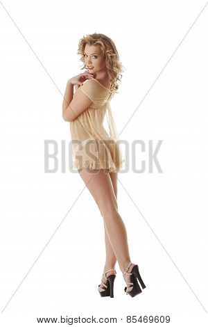 Flirtatious blonde dressed in erotic negligee
