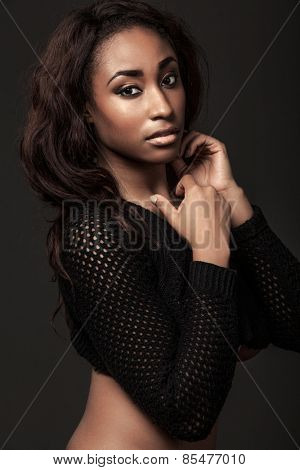 Young attractive African-American model with long hair.