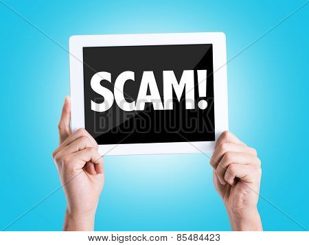 Tablet pc with text Scam! with blue background