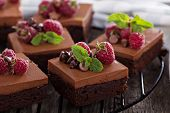 Chocolate mousse brownies with raspberry on a cooling rack poster