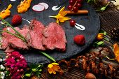 slices of duck fried meat in fancy food arrangement poster