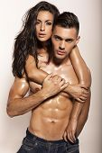 fashion photo of sexy impassioned couple posing in studio poster
