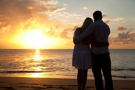 Silhouette Of Couple On A Beach At Sunset