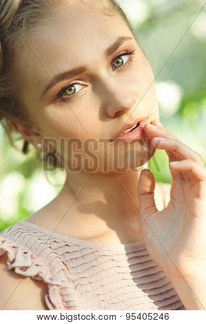 Beautiful girl with makeup and hairdo with tress, summertime.