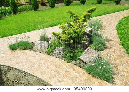 Beautiful view of yard with green grass and bushes poster