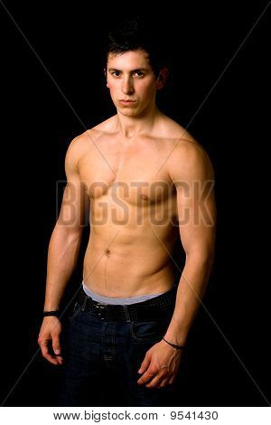 Young man with atletic body on black background poster