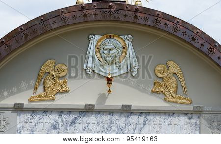 Lunette on Orthodox church with face of Jesus and two angels