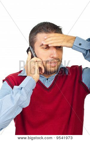 Confused Man Talking By Phone Mobile