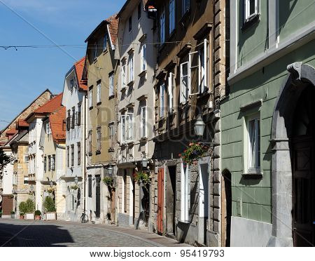 Old street in European town converging in perspective