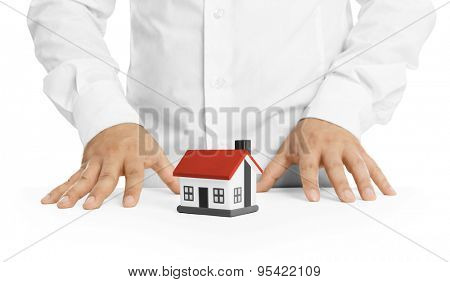 Real estate agent with house model -Concept of deal and real estate