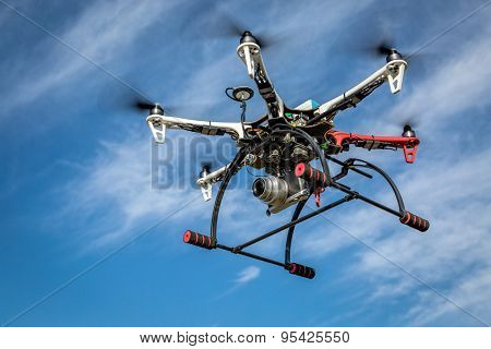 FORT COLLINS, CO, USA, JULY 15,  2015: DJI  F550 Flame Wheel hexacopter drone flying with the Pentax Lumix GM1 camera for aerial photography mission.