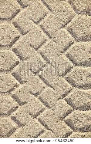 Tyre mark pattern in the sand