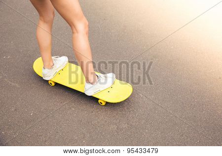 Closeup portrait of a female legs on skateboard