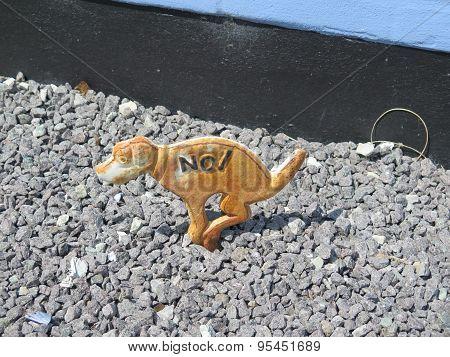 Metal Dog In Gravel