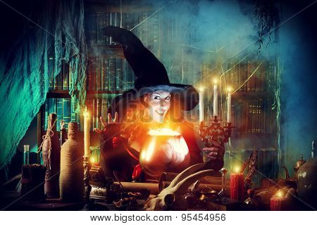 Attractive witch in the wizarding lair. Fairytales. Halloween. poster