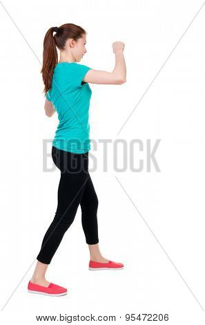 skinny woman funny fights waving his arms and legs. Rear view people collection.  backside view of person.  Isolated over white background. Sportswoman in tights coached impact protection.