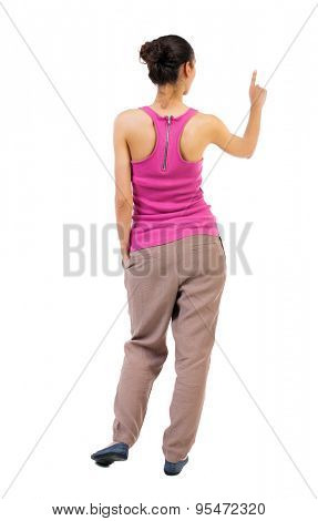 back view of woman. Young woman presses down on something. Isolated over white background. backside view of person. African-American woman standing with his hand in his pocket a second hand presses. poster