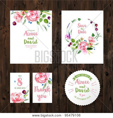Wedding cards with watercolor flowers on wooden background