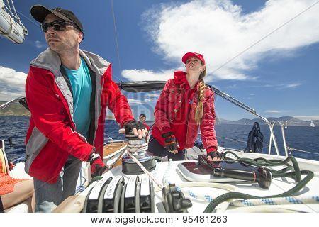 POROS - ERMIONI, GREECE - CIRCA MAY, 2014: Sailors participate in sailing regatta 11th Ellada 2014 among Greek island group in the Aegean Sea, in Cyclades and Argo-Saronic Gulf.