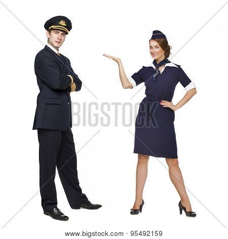 Captain of the aircraft and a beautiful flight attendant in a dark blue uniform, isolated on white background