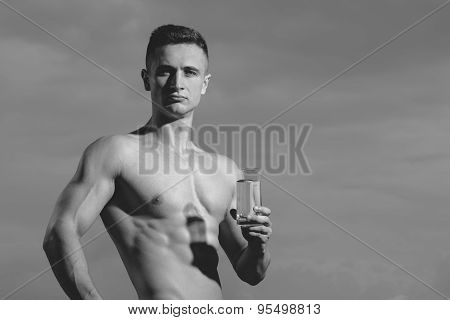 Sensual Bodybuilder With Glass Of Water