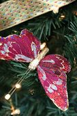 butterfly christmas decoration on a xmas tree poster