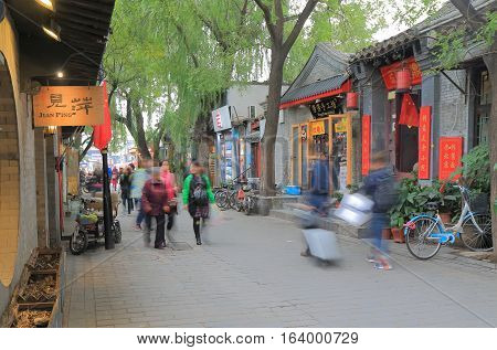 BEIJING CHINA - OCTOBER 27, 2016: Unidentified people vist Nanluoguxiang lane. Nanluoguxiang lane has become a popular tourist destination with restaurants and bars.