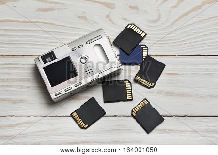 Flash Cards Sd And Compact Digital Camera On Wooden