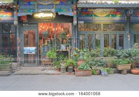 BEIJING CHINA - OCTOBER 27, 2016: Nanluoguxiang lane. Nanluoguxiang lane has become a popular tourist destination with restaurants and bars.