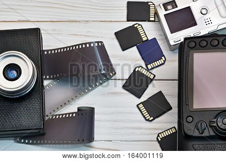 Retro Camera With Film And Modern Digital Compact
