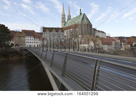Bridge across the river Neisse with the Peterskirche church in Goerlitz in the background