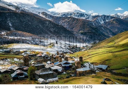 Svan Towers and ancient Jgrag church in Ushguli commune. View from above. One of the highest inhabited village in Europe. Caucasus Upper Svaneti Georgia. UNESCO World Heritage Site. View of Zhibiani Chvibiani and Chajhashi. Georgian landmarks