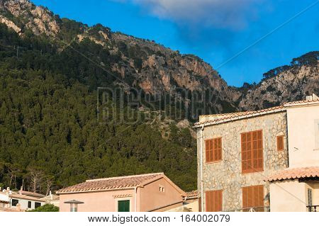 View from the port of Valldemossa to the mountains with the narrow access road.