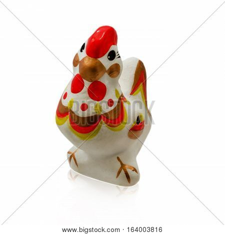 Cock isolated on a white background. Toy souvenir