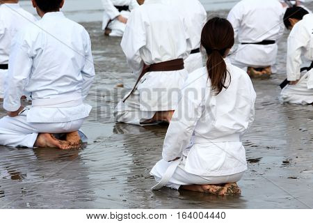 Training of Karate at the beach of midwinter, Japan