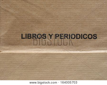 Libros y periodicos (meaning books and journals) printed on a light brown envelope