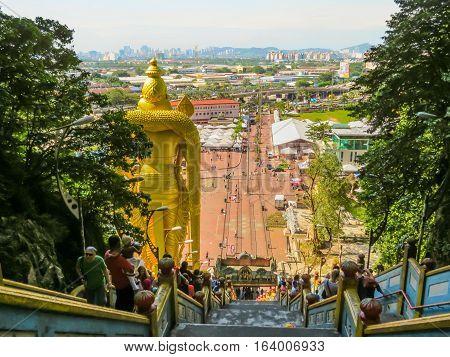 KUALA LUMPUR, MALAYSIA - JANUARY 13, 2014: Pilgrims and visitors on a huge ladder to Batu Caves. Kuala Lumpur, Malaysia