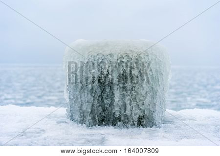 Frozen pier for ships ice block close up