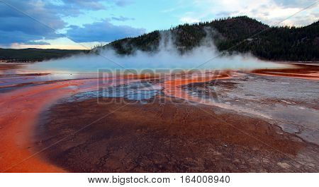 The Grand Prismatic Spring at sunset in the Midway Geyser Basin along the Firehole River in Yellowstone National Park in Wyoming U S