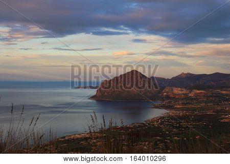 Beautiful autumn sunset in Erice, Sicily. Landscape of Egadi's archipelago.