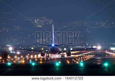 OSAKA, JAPAN - JAN. 2, 2017: Boeing 737-800 taking off from the Itami International Airport in Osaka, Japan in the night.