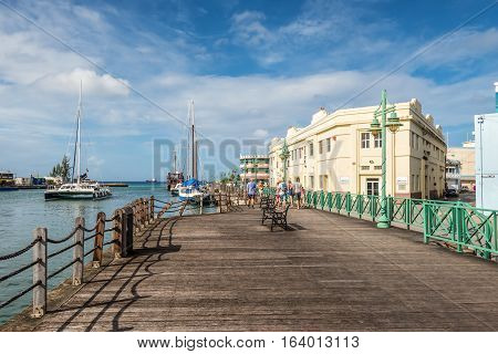 Bridgetown Barbados - December 18 2016: Wooden quay of downtown at the Port of Bridgetown Barbados. Historic Bridgetown and its Garrison is a World Heritage Site of UNESCO.