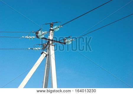 Support of rural power lines over clear cloudless blue sky