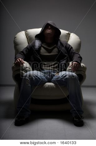 Dangerous Man Sitting In White Chair